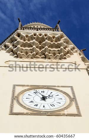 Clock and minaret of mosque in Manama city, Bahrein - stock photo