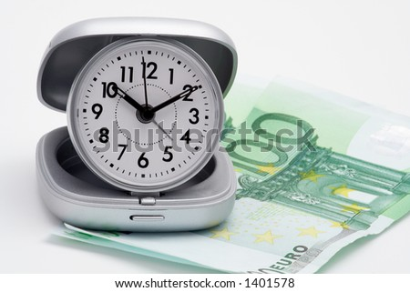 Clock and money (euros), isolated on white background - stock photo