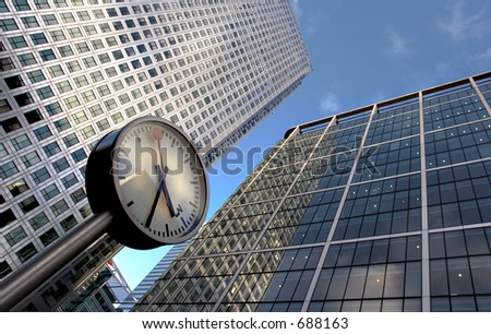 clock and office buildings - stock photo
