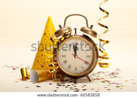 Clock and party decorations - stock photo