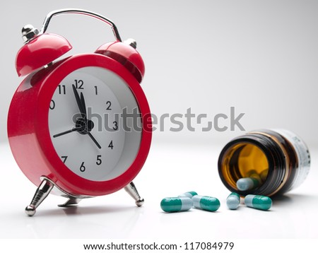 clock  and pills , for healthcare, medicine, addiction themes - stock photo