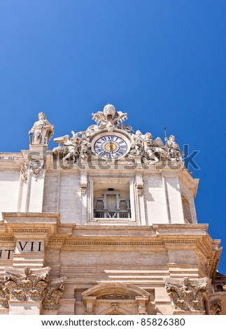 Clock and statues in St. Peters Basilica on blue sky - stock photo
