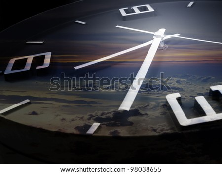clock and time running with sun set backgroud - stock photo