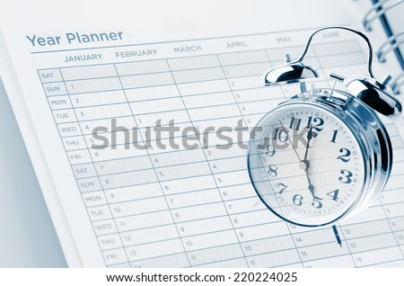 Clock and year planner page - stock photo