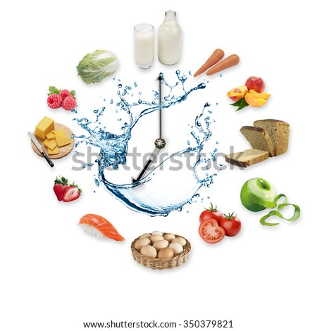 Clock arranged from healthy food products splash by water isolated on white background. Healthy food concept. - stock photo