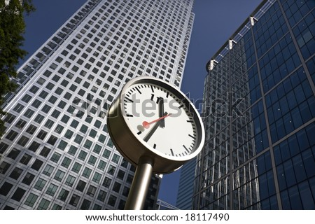 Clock at Canary Wharf in London Docklands financial district - stock photo