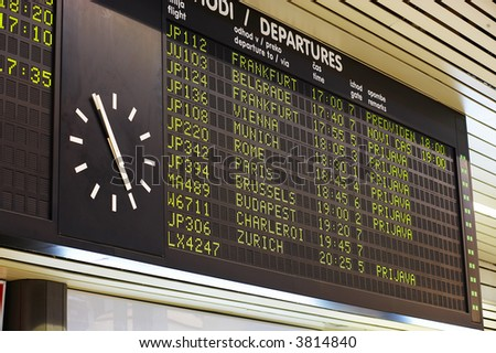 clock at the arrival-departure board - stock photo