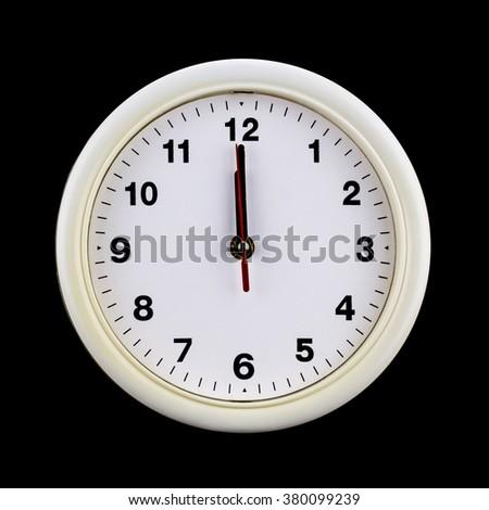Clock at twelve isolate on black - stock photo