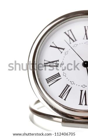 Clock close-up isolated on white - stock photo