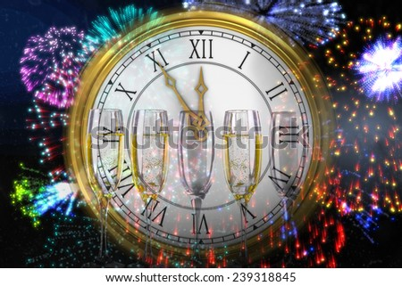 Clock counting down to midnight against three full glasses of champagne - stock photo