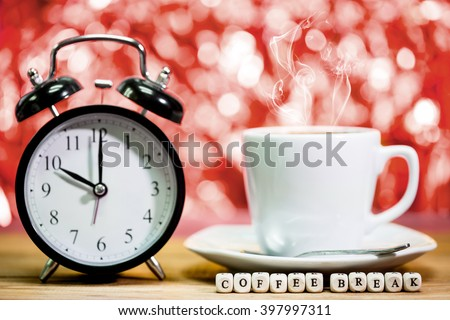 Clock. cup of fresh espresso with clock sign,with coffee break message - stock photo