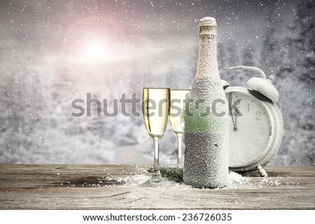 clock desk bottle and glasses of champagne  - stock photo
