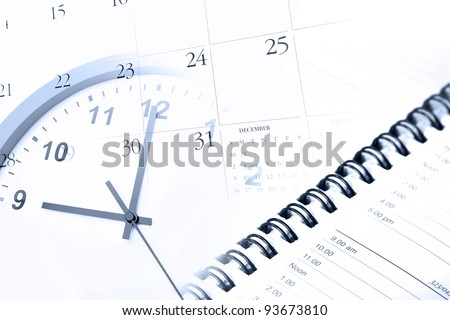 Clock, diary and calendar page - stock photo
