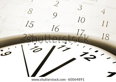 Clock face and calendar numbers - stock photo
