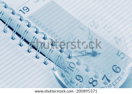 Clock face and diary pages - stock photo