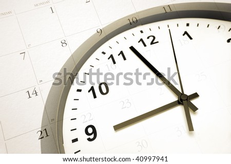 Clock face on calendar - stock photo