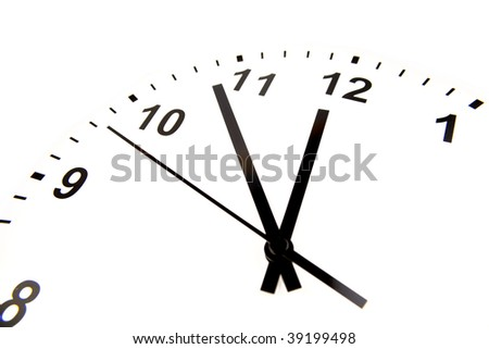 Clock face on white background. Hands pointing to midday.