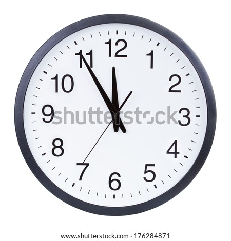 Clock face showing the hands at five minutes to midnight - stock photo