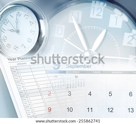 Clock faces, calendar and year planner - stock photo