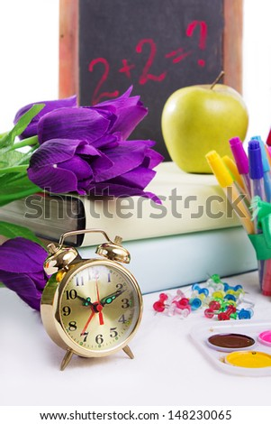 Clock, flowers and apple, back to school concept isolated - stock photo