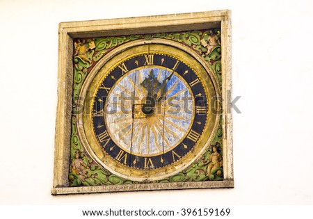 clock ,green clock on the wall, green and yellow clock ,minutes ,seconds ,antique clock,watch ,green clock with yellow ,black ,vintage clock ,culture ,old times clock ,traditional ,estonia ,tallinn - stock photo