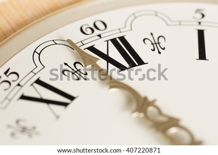 Clock Hand Close Up with Roman Numerals
