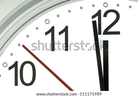 clock hands indicate almost twelve - stock photo