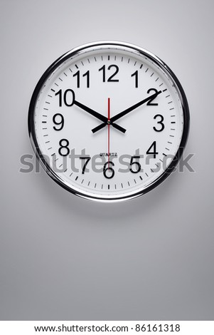 Clock hanging on the wall - stock photo
