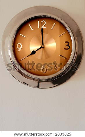 Clock hanging on the wall. It is indicating eight o'clock - time to start working. - stock photo