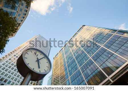 Clock in Canary Wharf in London's financial district, time in business concept