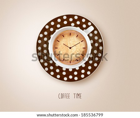 Clock in coffee cup - stock photo