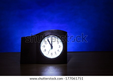 Clock in the Dark Room with display Almost Midnight - stock photo