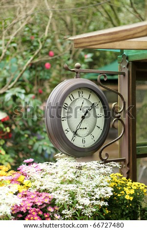clock in the garden - stock photo