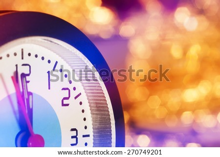 clock is almost the new year 23:59 on a beautiful festive background with bokeh - stock photo