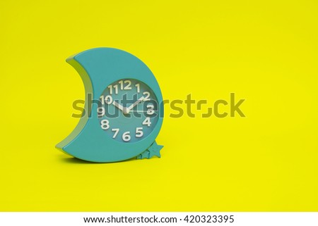 clock isolated on the yellow - stock photo