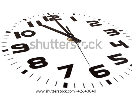 Clock isolated on white marking the eleven o'clock hour. The main focus is in the hour hand. - stock photo