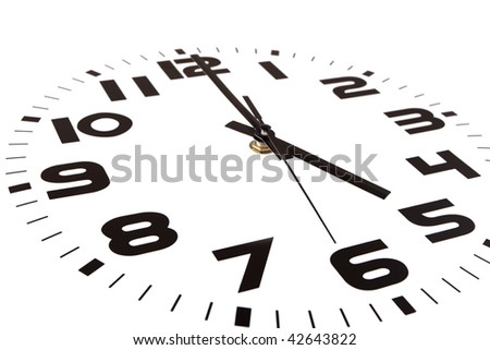 Clock isolated on white marking the five o'clock hour. The main focus is in the hour hand. - stock photo
