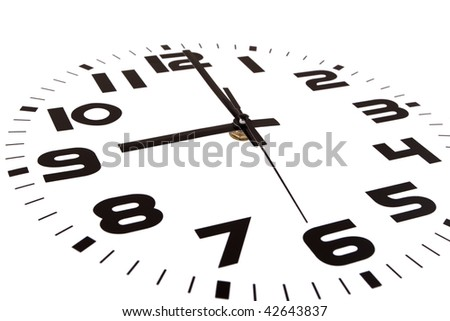 Clock isolated on white marking the nine o'clock hour. The main focus is in the hour hand. - stock photo