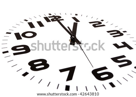 Clock isolated on white marking the one o'clock hour. The main focus is in the hour hand. - stock photo