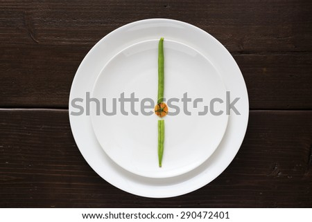 Clock made by vegetable - stock photo