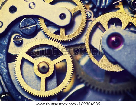 clock mechanism made in the technique of toning. Very shallow depth of field. Focus on the left gears - stock photo