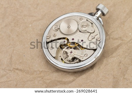 clock mechanism on the white background - stock photo