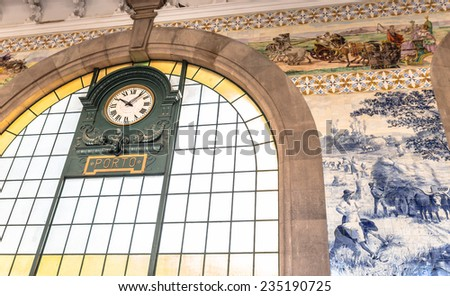 Clock of the historical Sao Bento train station in Porto, Portugal. - stock photo