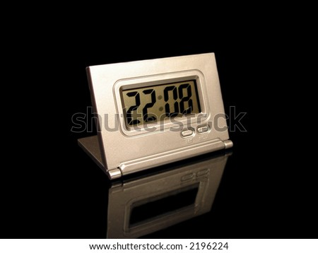 clock on a black background with reflection - stock photo