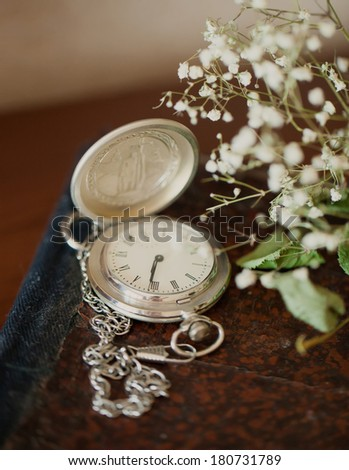 clock on a book - stock photo