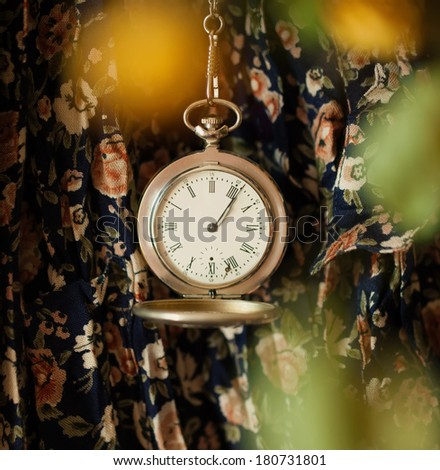 clock on a floral background - stock photo