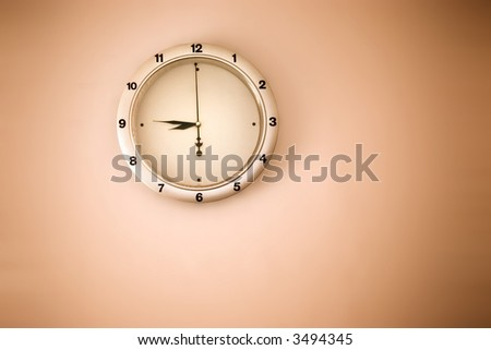 Clock on a wall. Red retro tint. - stock photo