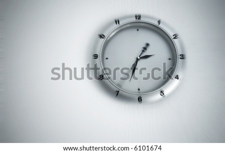 Clock on a wall with blur effect. - stock photo