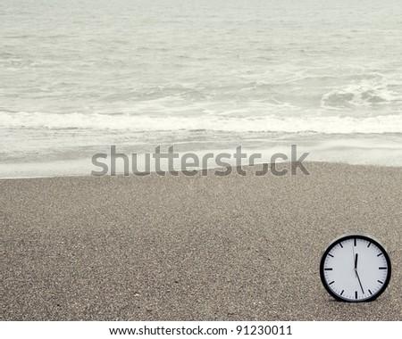 Clock on beach - stock photo