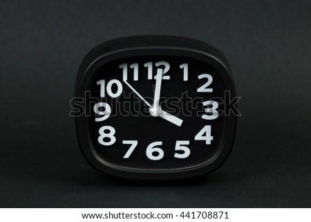 clock on black background - stock photo